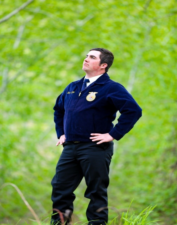 Student poses in FFA jacket